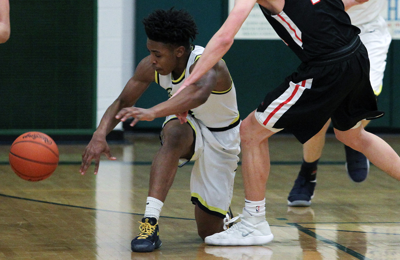 Clarkston defeats Troy 71-46 in regional semifinal basketball action at West Bloomfield High School Monday, March 12, 2018. (For The Oakland Press / LARRY McKEE)