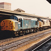 37078 + 37215 heads a short tanker train through Reading on 5th August 1989