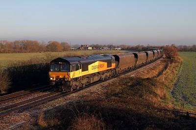 66848 on the 4V30 0825 Ratcliffe PS-Portbury empty coal at Lockington on the 13th December 2014