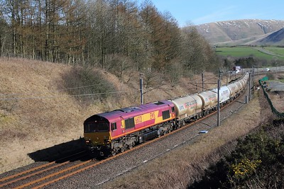 66021 on the 6M00 Mossend to Clitheroe at Beck foot on the 24th March 2017