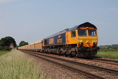 66702 'Blue Lightning' strolls through Rearsby east of Syston powering the delayed 6L76 Stud Farm to Whitemoor yellow box train on the 18th June 2013