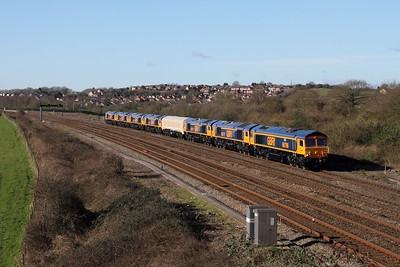 66708, 66777, 66776, 66779 in tarpaulins, 66778, 66774, 66773 and 66775 on OX66 1045 Newport Docks to Doncaster approaching Severn Tunnel junction on the 15th February 2016