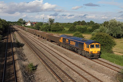 66704 leads 6V83 Peterborough to Moreton on the Lugg stone train at Undy on the 8th July 2014