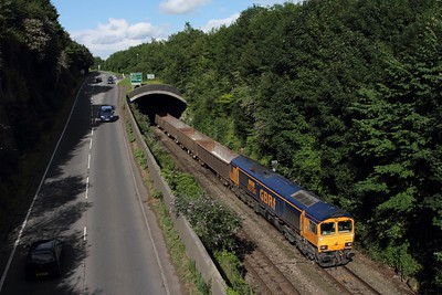 66704 leads 6V83 Peterborough to Moreton on the Lugg stone train at Sedbury on the approach to Chepstow on the 8th July 2014