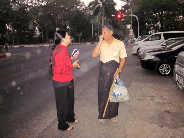 caption credit: tin naing :))<br /> <br /> SLK: What' s that stick for, KMM?<br /> KMM: It's not just a simple walking stick as everyone thinks. It's a magic stick  It can turn DG and Amutkyi into lushwindaws.