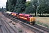 "9 July 2003 :: 37051 ""Merehead + 66057 haul 3 fuel oil wagons and are seen at Millbrook"