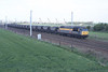 "14 May 1996 :: 56049 in ""Dutch"" Transrail livery is seen at Winwick Junction"