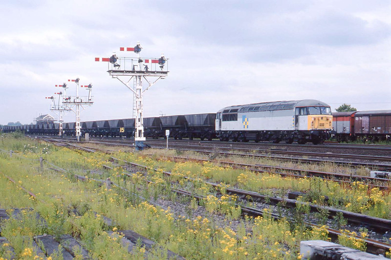 4 July 1995 :: Despite now having Construction sub-sector decals 56041 is in charge of a coal train alongside the unique signal gantries at Wrawby Junction
