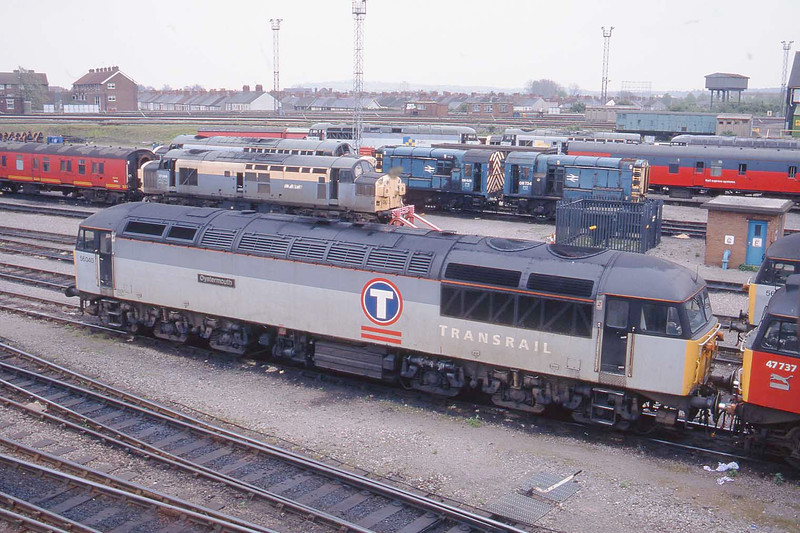 """17 April 1997 :: 56040 """"Oystermouth"""" in Transrail branding is pictured at Cardiff Canton"""