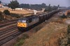25 September 1998 :: Metals sub-sector 56043 pulls a rake of coal wagons past Milford Junction