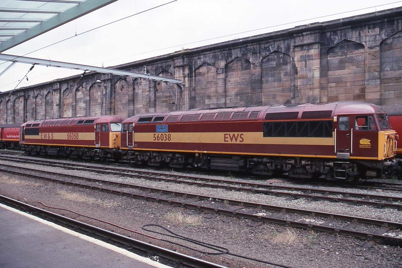 """1 July 2003 : 56038 """"Western Mail"""" with 56058 are parked up in Carlisle.  Note the different EWS and EW&S branding on the two locomotives"""