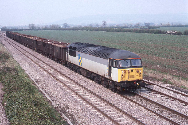 10 April 1992 :: 56046 with a scrap metal train passing Aschurch