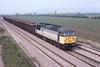 10 April 1992 :: 56046 with a scrap metal train passing Aschurch