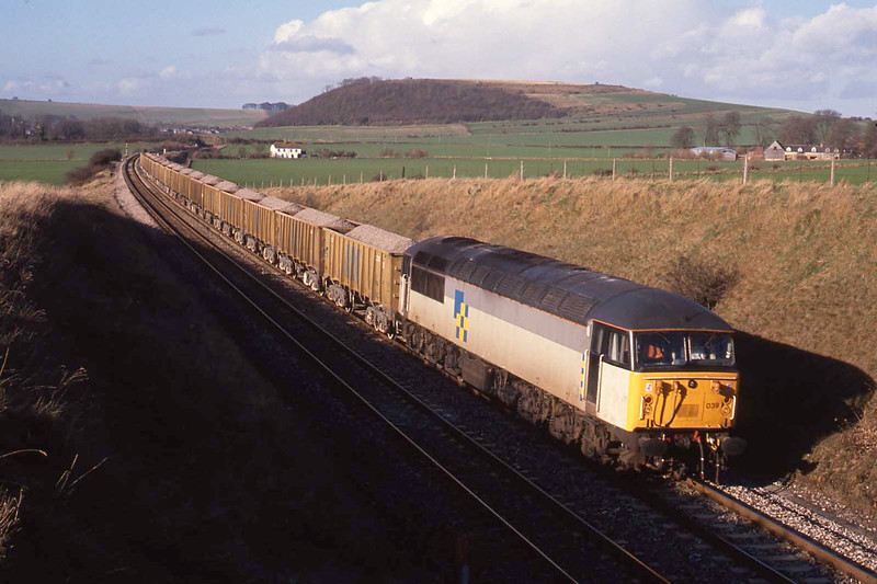 17 January 1990 :: Construction sub-sector 56039 is heading south at Warminster with a loaded stone train