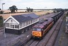 """24 June 2003 :: 56038 """"Western Mail"""" is passing the signal box at Brocklesbury Junction with a loaded coal train in MGR hoppers"""