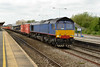 15 May 2014 :: Now in the Freightliner pool, 66414 has a signal check at Swindon while leading 4L32 from Bristol to Tilbury.  The blue livery remains from when the locomotive had the full Stobart Rail treatment while with DRS
