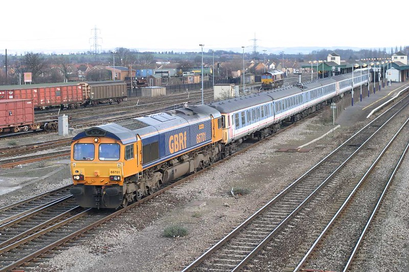 22 February 2016 :: 66701 in its original livery is passing through Didcot with a rake of redundant Class 312 EMU's that were being taken from Shoeburyness to Caerwent for scrapping