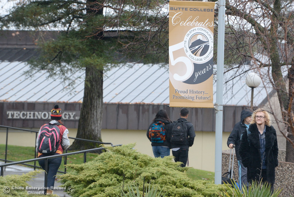 . Students walk past banners commemorating Buttes 50th year as they roam around campus on the first day of the spring semester at the Butte College Main campus Monday Jan. 22, 2018. (Bill Husa -- Enterprise-Record)