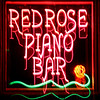 Red Rose Piano Bar on Hwy 111 near the Pickford Theatre.