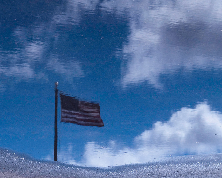 US Flag in puddle
