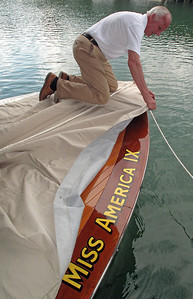 Charles Mistele attaches the deck cover onto Miss America IX while preparing her for an overnight stay Wednesday, June 4, at the Ridges Resort Marina on Lake Chatuge near Hiawassee, GA. Charles brought Miss America IX to Lake Chatuge for the 27th Annual Lake Chatuge Rendezvous, held by the Blue Ridge CHapter of the ACBS. Miss America IX is a hydroplane built and raced by Gar Wood in the early 1930s.