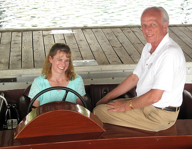 Kirsten Johnson, left, and Charles Mistele sit in the cockpit of Miss America IX, a 1930 hydroplane built and raced by Gar Wood. Johnson is part of Wood's extended family, and paid Mistele a visit to learn what she could about her great-uncle's racing exploits and boat building business. Mistele has owned the boat for many years. Johnson met Mistele during the ACBS Blue Ridge Chapter's 27th Annual Lake Chatuge Rendezvous.