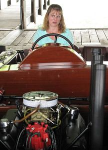 Kirsten Johnson reacts the feeling of power after starting the engines of Miss America IX, a 1930 hydroplane built and raced by her great-uncle Gar Wood. Johnson has been researching her family history for a couple of years, and met with Charles Mistele, owner of Miss America IX to learn more about Woods' racing exploits.
