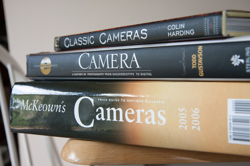 "A few of my books, including the 1200+ page McKeown's Price Guide to classic and antique cameras (which I refer to as my ""shopping list"").  Most basic information on the cameras on this site comes from McKeown's, the manuals or just by examining them for maker's marks or patent dates.  If I pull information from other sources I try to cite them in the profiles."
