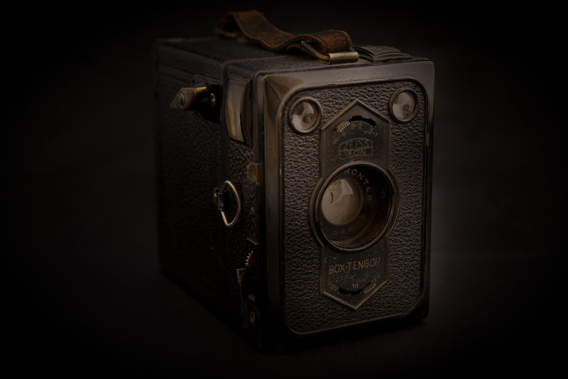 The Box Tengor has a reputation as being one of the better box cameras.  This is the 54/2 version, which produces 6x9 negatives on 120 film.  The Box Tengor was a product of Zeiss, one of the most legendary names in photographic history.  The Tengor was produced in various forms from the 1920s- 1950's, this version was produced from 1934-1938.  Unlike most box cameras, the camera could be focused to different distances by the use of supplementary lenses that are moved into place inside the camera, it also had a choice of three apertures.