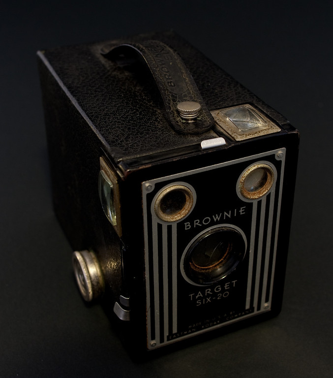 The Brownie Target six-20 is a simple box camera produced from 1946 to 1952 by Kodak.   It was designed for obsolete 620 film (hence the name), but you can just re-roll still available 120 film on old 620 reels making it still easy to use.  The camera has a single shutter speed, but does have two aperture settings which gives at least some exposure control.