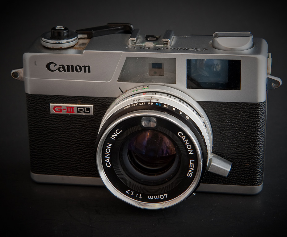 My canonet G III QL 17 is one of my favorite cameras.  It's what I grab when I don't want to drag around an SLR but sill want the simplicity of a built in light meter.   This version of the Canonet was first produced in the 1970's and lasted till the 1980's.  It's a fixed lens rangefinder with a 40mm lens that is quite sharp.