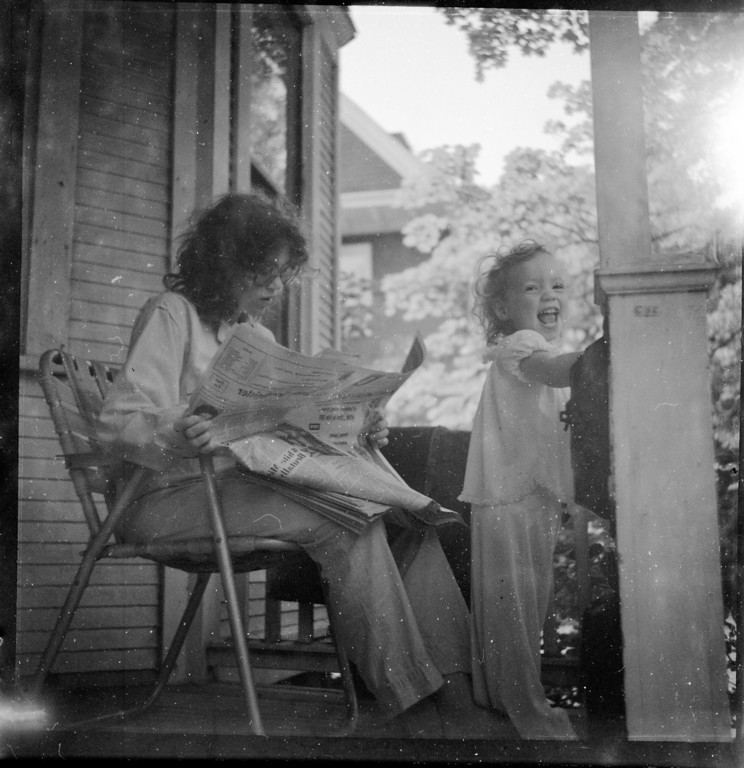 The film turned out to be a set of someone's little girl.  I'm not sure if the other person is the mother or a different family member.  Check out those glasses.  I can't read much from the newspaper, best that I can make out is that it was the ------- Register.