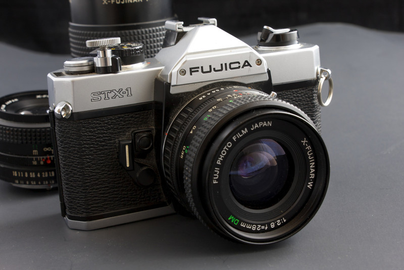 The Fujica STX-1 was introduced in the late 1979 and produced for only a few short years.  It's a totally manual camera but does have a built in meter, which still seems to be working fairly well.  The odd thing about this camera is that it has a top shutter speed of 1/750, most cameras that I know of typically had top shutter speeds of 1/500 or 1/1000, so this one is a bit of an odd duck.  Really it has everything I like to see in a SLR.  Simple design, operates without batteries (except for the light meter), and solidly built.<br /> <br /> Fujica SLR's really aren't all that well known, and I couldn't find all that much information on them.  Based on what I gathered from miscellaneous sources of questionable accuracy on the internet, it sounds like Fuji shot themselves in the foot with the lens mount.  The X-mount lenses used by this camera were introduced in 1980 which replaced the m42 screw-mount found on older Fujica cameras, which would have angered anyone who was already invested in Fujica system.  Then Fuji apparently discontinued the X-mount only five years later.  So I can see why these cameras really aren't that well remembered today.