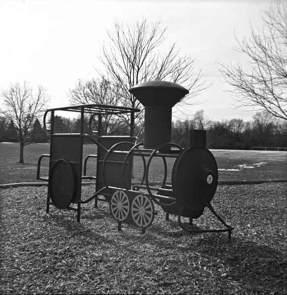 There is a small park and playground that within walking distance of my apartment, so I decided to take the camera over there one grey afternoon to put it through it's paces.  The light was an almost perfect match to the single aperture and shutter speed combination the camera is limited to.