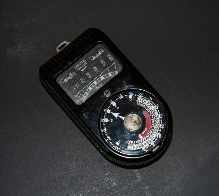 """Weston Master (1939-45)<br /> <br /> Even a small light meter collection such as mine would be incomplete without at least one of the famous Weston meters. Weston meters are fairly easy to find, finding a working one is a bit of a challenge.  My master has had a rough life, but still works just fine.  Unlike most other meters, the selenium cell is located on the """"back"""" of the meter, which requires you to hold the meter vertically.  The dial is rather complex compared to some other meters, but once you figure it out using it isn't difficult.<br /> <br /> For a more complete history of the Weston meters see the following site.<br />  <a href=""""http://www.westonmeter.org.uk/"""">http://www.westonmeter.org.uk/</a>"""