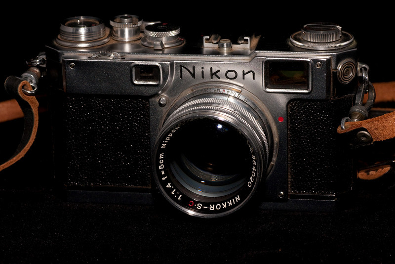 The Nikon S2 rangefinder was made during the mid 1954-1958.  This example has the el-Nikkor 50mm 1.4 lens.  The S2 is one of the more common Nikon rangefinders.  The earlier Nikon S produced non-standard frame sizes that some professionals didn't care for, Nikon corrected that problem with this model.  The Nikon rangefinders are still well-respected today for good reason.  They are solid, dependable cameras.