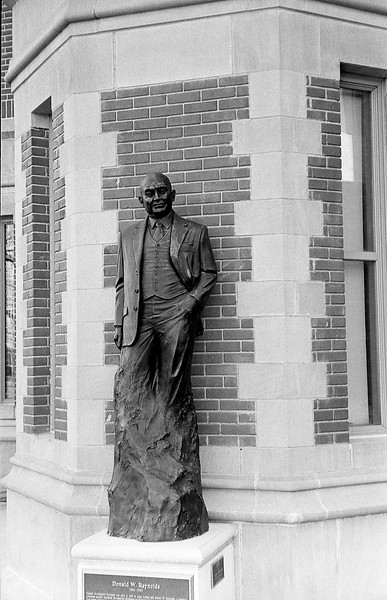 The university of Oklahoma is covered with statues, many of which have more serious expressions on their face, this one however has a more natural and relaxed look which I like much more.