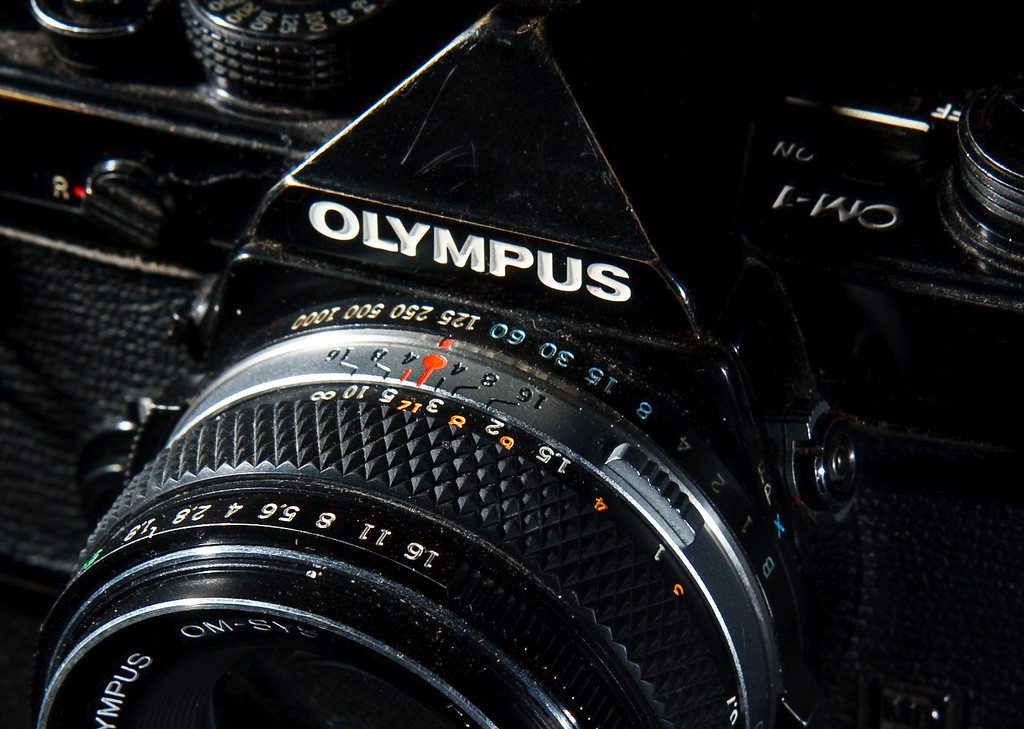 I bought my OM-1 at an estate sale a few years ago.  The guy must have liked them, as he had at least three. Many of my cameras are almost pristine, as if they were rarely used.  Not this one, the heavy brassing shows that this was a camera that was actually used on a regular basis. I think in many ways I prefer cameras that have some wear, makes one wonder what all was seen through the lens.