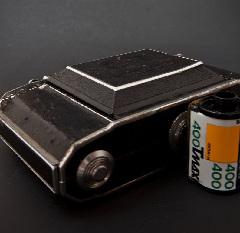 The great thing about folding cameras is that they collapse to such a small size as you can see here.  Collapsed I can just fit this camera into my pocket, try doing that with other medium format cameras such as Hasselblad!  35mm film canister for scale