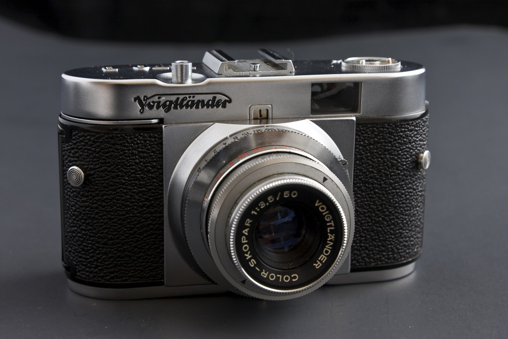 The Voigtlander Vito B is a small camera that is another great example of the high standards of the mid 20th century German camera industry.  It's elegant styling really stood out when I spotted in on a camera covered table at a camera show last year.  It's quite small, not much taller than the 35mm roll of film it uses and easily fits in a jacket pocket.  If you handle the camera, that first thing that will you'll notice is how surprisingly heavy it is for it's size, its a very solid and well made camera.