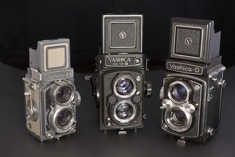 My three Yashica TLR's, the Yashica 44, Yashica 124G, and Yashica D.  Personally, I actually prefer the Yashica D even though it was a low price alternative to the124G and lacks the crank advance, as I find the chrome more aesthetically pleasing.  The fact that my Yashica D is the somewhat uncommon version featuring the same viewing and taking lens as the 124G means there is no difference in image quality despite it's lower price.
