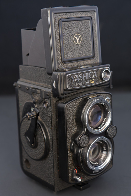 In 1971 Yashica introduced their final twin lens reflex, the Yashica Mat 124G.  The 124G was Yashica's top of the line model, featuring a built in CDS light meter, crank film advance, and could use either 120 or 220 size film.  Today the camera has become somewhat of a cult classic due to the cameras high quality and full feature set.