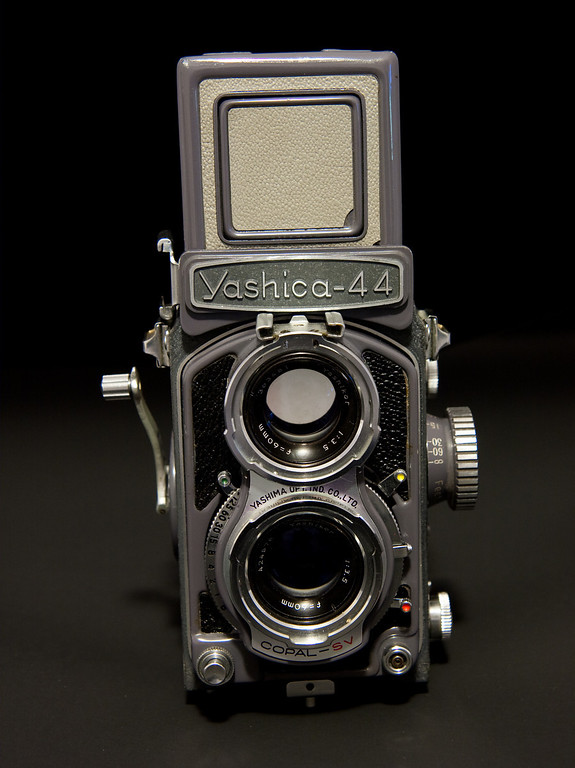 "The Yashica 44 is a ""baby"" twin lens reflex which was introduced in 1958.  It uses 127 film producing 4x4cm negatives, a film which was more or less extinct for awhile when Kodak stopped producing it in the 1990's.  However there are a few companies that have reintroduced the format, film choices are limited but at least it is fairly easy to find,  The camera is solidly built and works fine.  My example is in great shape except for the leather."