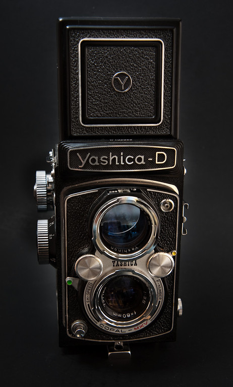 Probably the nicest looking camera in my collection is this Yashica D Twin Lens Reflex.  Made from 1959-1974 it had a relatively long production run, especially when compared to today's digital world in which many cameras don't last much longer than a year or two.  Originally made with an 80mm Yashikor taking lens, later models such as this example came with the superior Yashinon lens, the same lens that comes on the better known, and three times more expensive yashica 124G.
