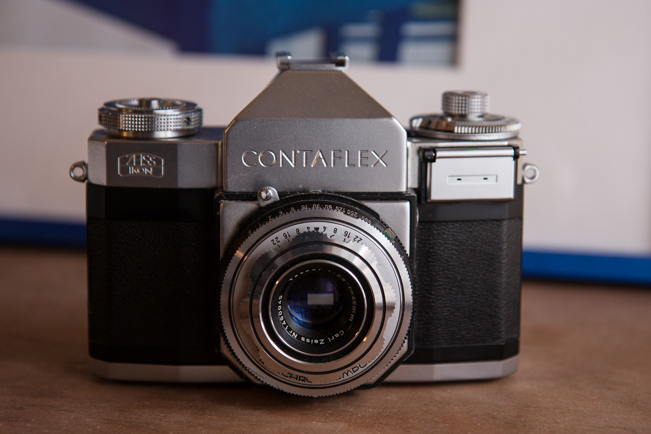 The Contaflex II was produced between 1954 and 1958.  Their are two sub-types of this model based on what meter is has.  This is the earlier dual-range meter version.  The Contaflex is a fixed lens SLR with a leaf shutter rather than the more common focal plane shutter seen in most SLRs.