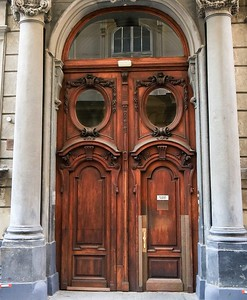 Fancy wood transoms and doors on a building in downtown Vienna.