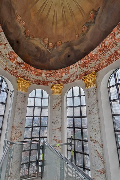 The uppermost frescoe in the tiny dome center has somewhat less detail than the other artwork. Not noticeable from the pews.