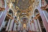 The frescoes of the Jesuit Church were done by the famous artist Andrea Pozzo beginning in 1703. He died unexpectedly in 1709 and is buried here.