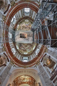 St. Charles Cathedral is unique in that visitors can ride an elevator to the top of the dome and view the frescoe restoration process.
