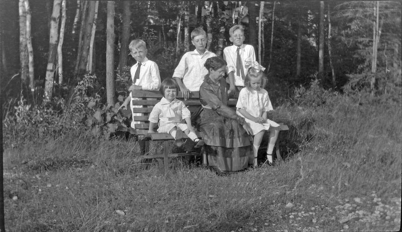 abc young George & Rowland Stebbins & old woman & 2 kids on Roaring Brook bench
